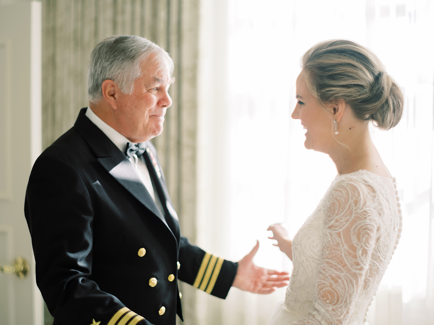 Father of the bride seeing her for the first time on her wedding day