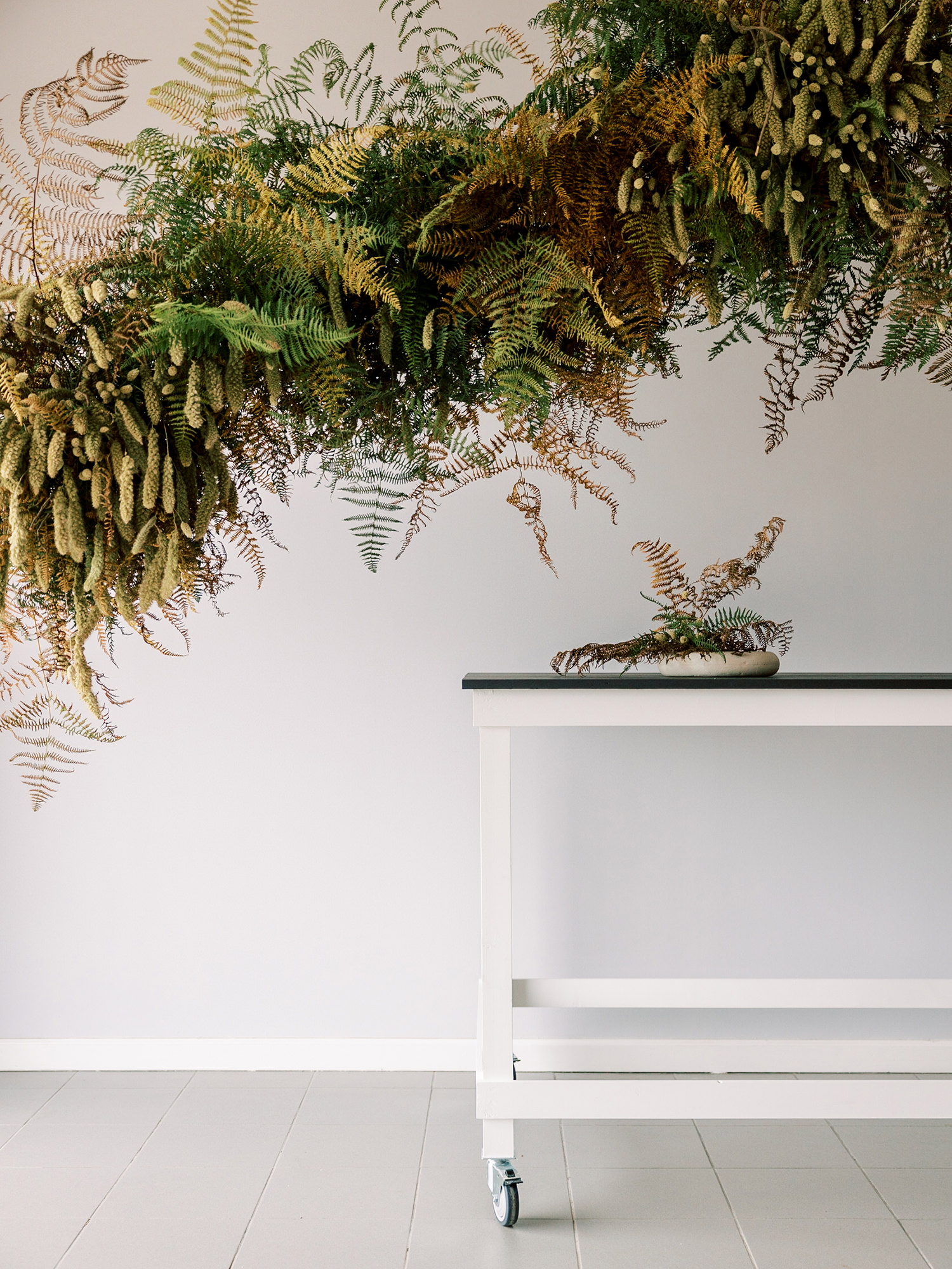 FLoral design using ferns and dried flowers and with no floral foam