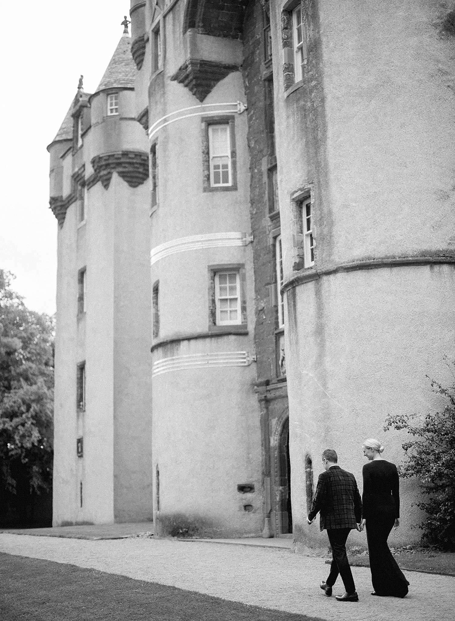 Couple walking outside of Castle Fyvie.
