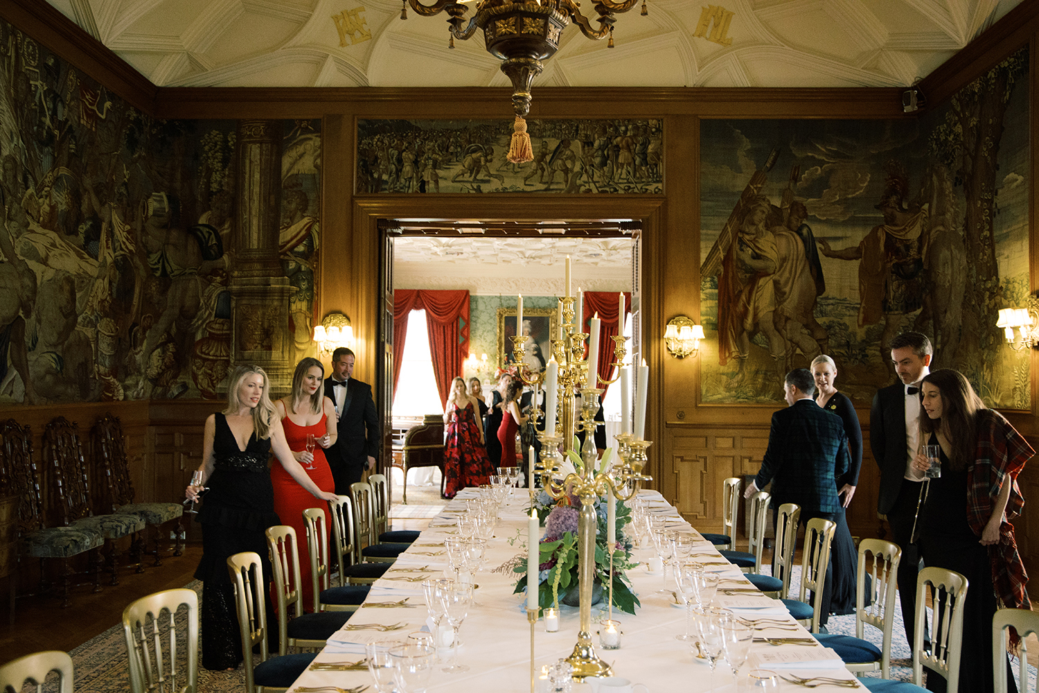 Guest entering the dinner room at this black tie surprise party at Fyvie Castle in Scotland